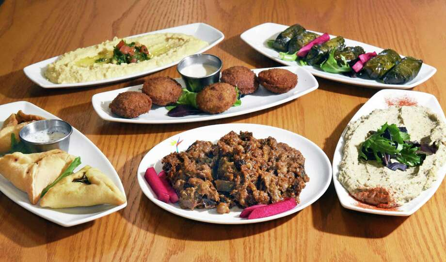 Click through the slideshow to learn more about a few restaurants our reviewer enjoyed this year with dishes ranging in price from less than $9.95 to $15.95. Photo: John Carl D'Annibale / 20040285A