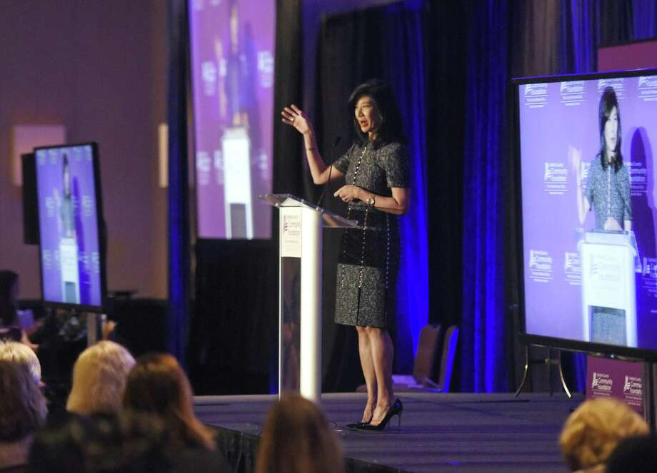 Avon CEO Andrea Jung delivers the keynote speech during the Fairfield County's Community Foundation's Fund for Women & Girls Annual Luncheon at the Hyatt Regency in Greenwich, Conn. Thursday, April 20, 2017. Women who benefited from the Family Economic Security Program spoke praises and Andrea Jung, the first female CEO at Avon, presented the keynote to a crowd of more than 700. Photo: Tyler Sizemore / Hearst Connecticut Media / Greenwich Time