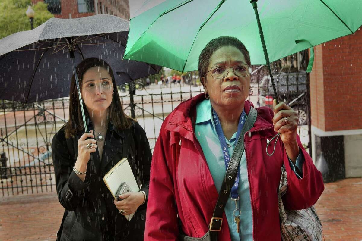 """This image released by HBO shows Rose Byrne, left, and Oprah Winfrey in a scene from HBO film """"The Immortal Life of Henrietta Lacks,"""" premiering Saturday at 8 p.m. EDT. (Quantrell Colbert/HBO via AP)"""