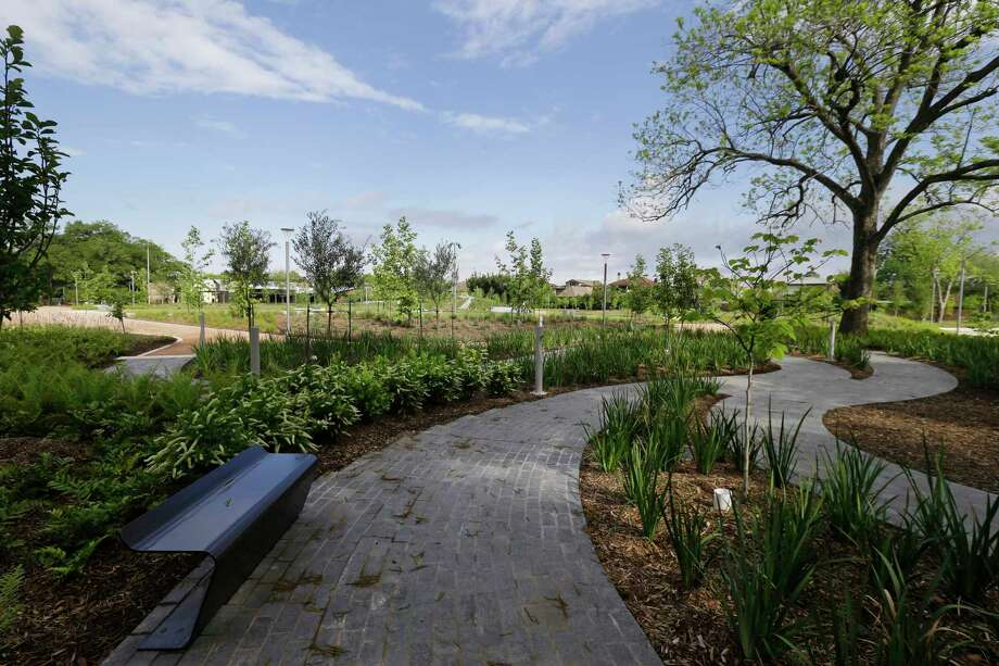 A path winds through Evelyn's Memorial Garden in Evelyn'•s Park, 4400 Bellaire Blvd., which opens Saturday. Photo: Melissa Phillip, Staff / © 2017 Houston Chronicle