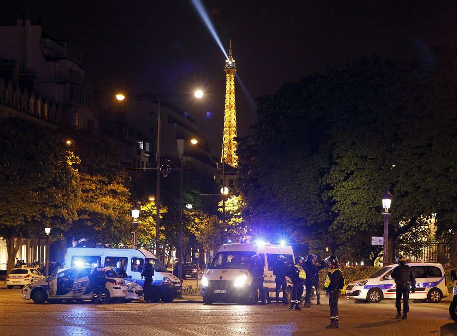 Police take positions near the Champs Elysees avenue in Paris, France, after a fatal shooting in which a police officer was killed along with an attacker, Thursday, April 20, 2017. French media are reporting that two police officers were shot Thursday on the famed shopping boulevard. Many police vehicles can be seen on the avenue that passes many of the city's most iconic landmarks. (AP Photo/Kamil Zihnioglu) Photo: Kamil Zihnioglu, Associated Press
