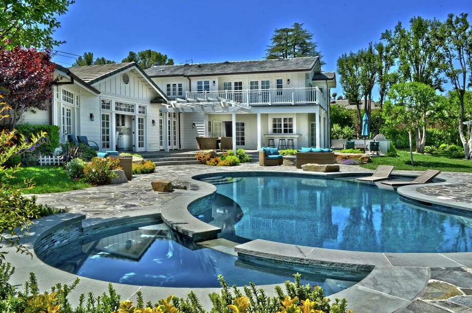 Los Angeles Lakers guard Nick Young is asking $3.595 million for the home in Los Angeles' Tarzana neighborhood that he bought three years ago from singer-actress Selena Gomez. The traditional-style home sits on about an acre of grounds and has a fenced basketball court, an outdoor kitchen and a swimming pool. (James Moss/TNS) Photo: James Moss / Los Angeles Times