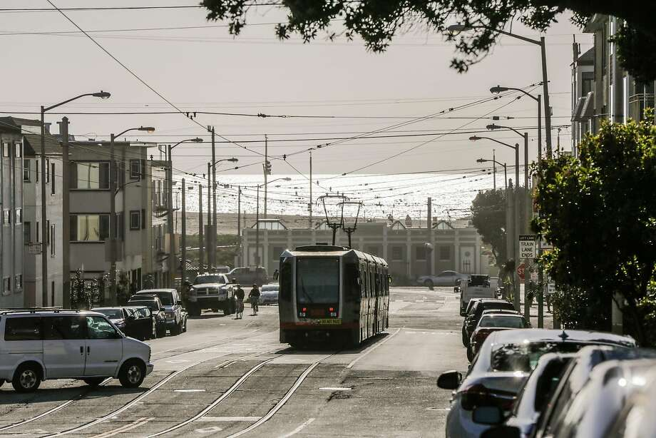 "Muni's N-Judah train rolls along on Judah Street. The line has the most ""switchbacks,"" in which trains are taken out of service to prevent bottlenecks. Photo: Gabrielle Lurie, The Chronicle"