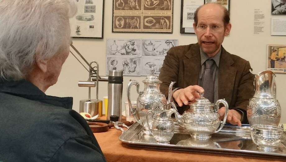 James Lipton, of Appraisers Associates, offers his opinion on a late 19th century German silver tea set during a program at the Westport Historical Society several years ago. Photo: Mike Lauterborn / File Photo / Westport News contributed