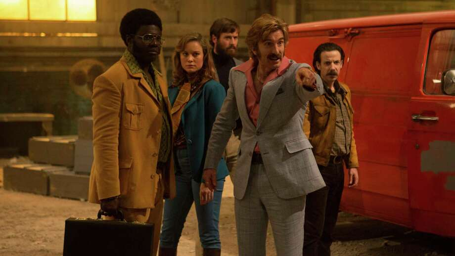 "This image released by A24 shows, from left, Babou Ceesay, Brie Larson, Armie Hammer, Sharlto Copley and Noah Taylor in a scene from ""Free Fire."" (Kerry Brown/A24 via AP) ORG XMIT: NYET823 Photo: Kerry Brown / A24"