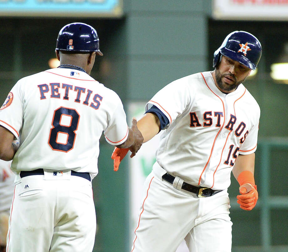 Houston Astros' Carlos Beltran (15) is congratulated by third base coach Gary Pettis after hitting a solo home run against the Los Angeles Angels in the first inning Thursday in Houston. Photo: George Bridges, FRE / FR171217 AP