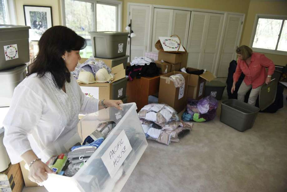 Undies Project Co-Presidents Laura Delaflor, left, and Lucy Langley unpack donated bras and underwear at Langley's home in Greenwich, Conn. Tuesday, April 18, 2017. Langley and Delaflor started the Undies Project two years ago and registered as an official nonprofit in November of 2016. The organization has collected and donated about 8,000 new pairs of underwear and new or gently-used bras in that time. Photo: Tyler Sizemore / Hearst Connecticut Media / Greenwich Time