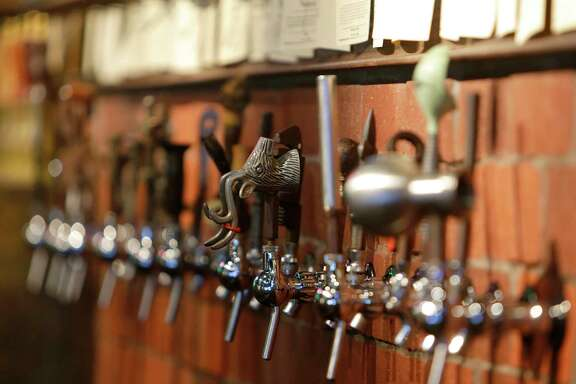 Main types of glassware for beer. Just a portion of the taps at The Hay Merchant, Tuesday, May 3, 2016, in Houston. ( Mark Mulligan / Houston Chronicle )