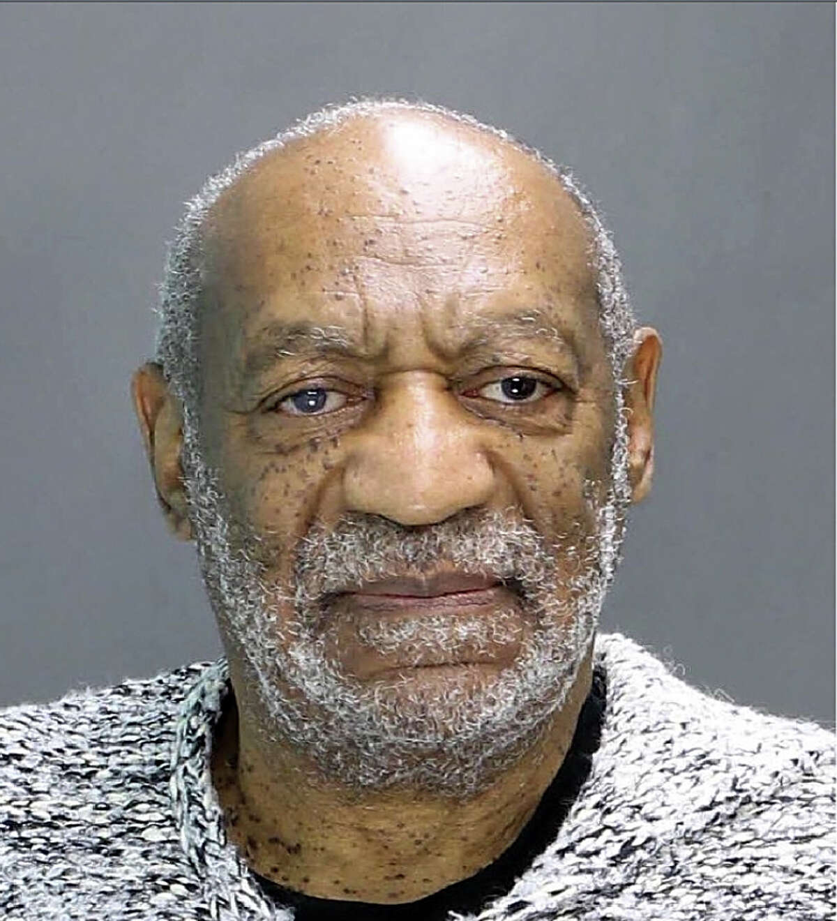 Bill Cosby This shot was taken when Cosby turned himself in on a charge of aggravated indecent assault for an alleged encounter in 2004. At least 35 women have accused Cosby of assaulting them.