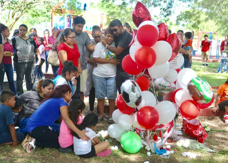 On Thursday, April 20, 2017 Family and friends turned out for a vigil for Juan Borja, an eighth-grade student at Freeport Intermediate School who was shot and killed Wednesday at a Freeport park. Police have arrested a 14-year-old in connection with the fatal shooting. Photo: Mark Mulligan |  Houston Chronicle