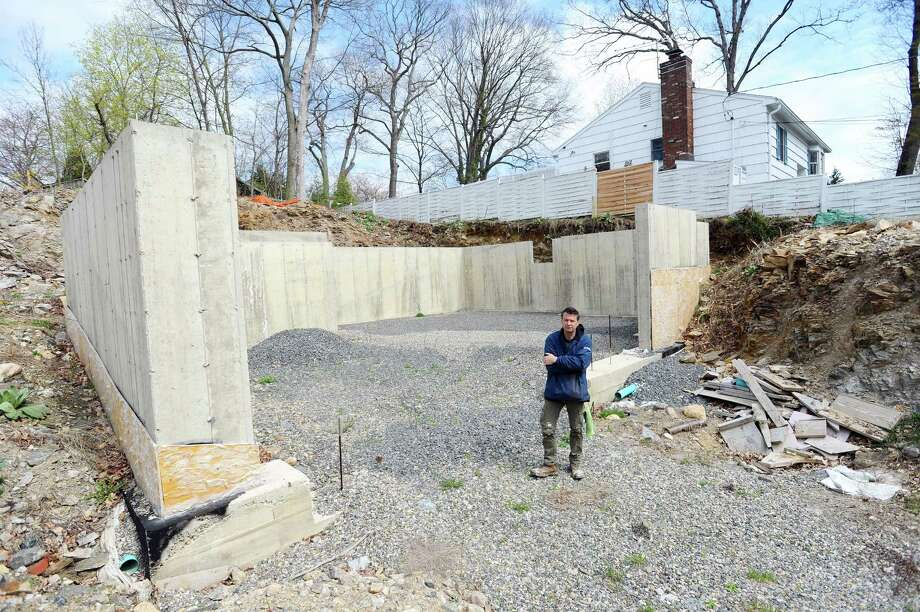 Springdale native Paul Trefry lives next door to a lot that has been under construction since 2014. Neighbors have been asking the builder, and now the city, to clean up the property and make it say. Photographed on Lawton Ave. in Stamford, Conn. on Wednesday, April 19, 2017. Photo: Michael Cummo / Hearst Connecticut Media / Stamford Advocate