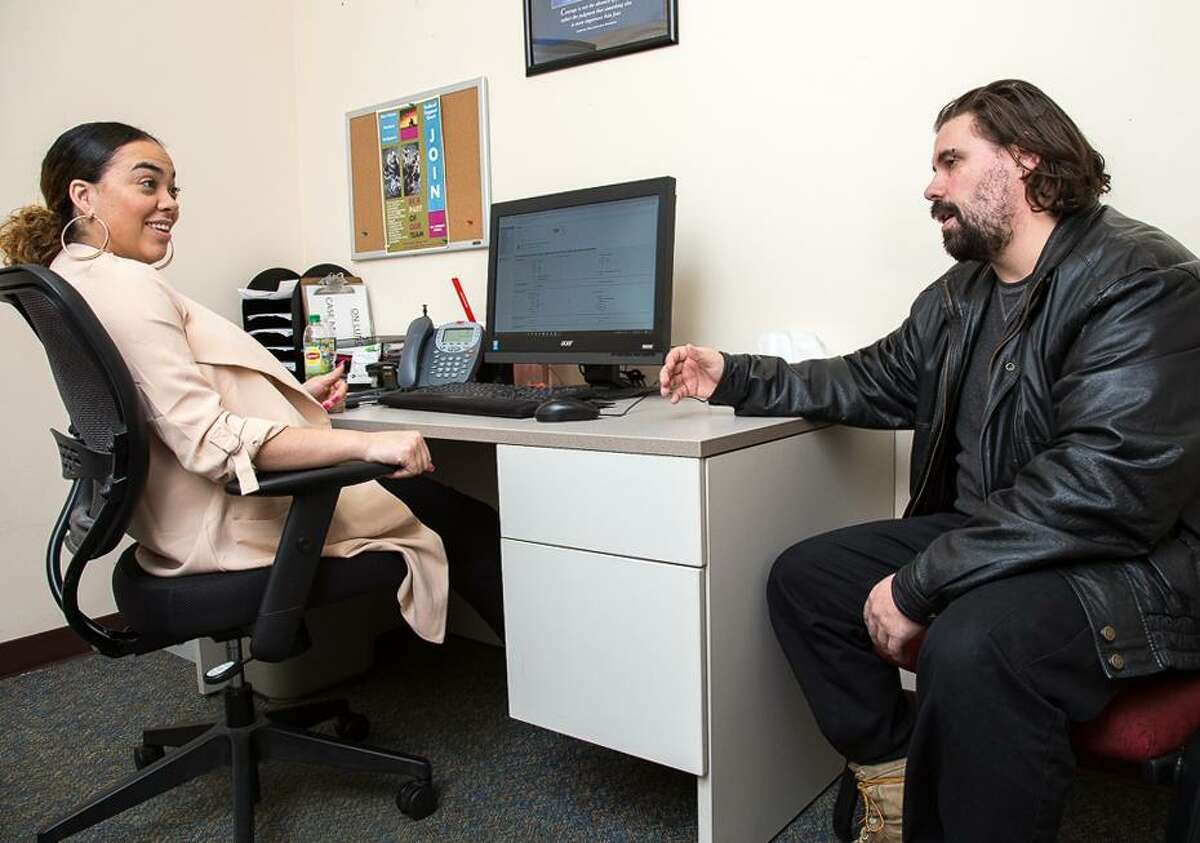 Daviana Contreras, case manager, meets with Jason Lerczak at the Community Renewal Team's Hartford office for Re-Entry Recovery Services. Lerczak served a 15-year prison sentence before he started using the services at CRT two years ago.