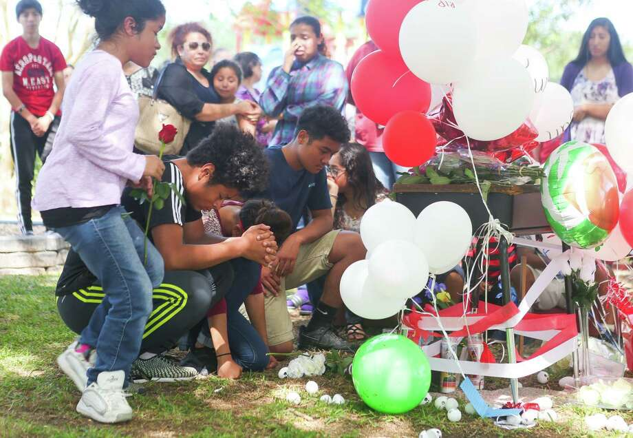 Family members mourn at a vigil at Peppermint Park where 13-year-old Juan Borja was shot and killed Wednesday night, during an afternoon gathering at the park, Thursday, April 20, 2017, in Freeport. Photo: Mark Mulligan, Mark Mulligan / Houston Chronicle / 2017 Mark Mulligan / Houston Chronicle