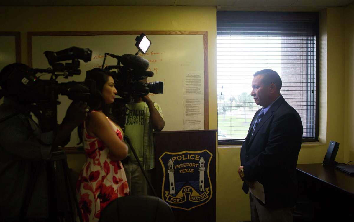 Captain Ray Garivey, with the Freeport Police Department, talks to members of the media about the suspect they arrested in connection with a shooting at Peppermint Park, Thursday, April 20, 2017, in Freeport.