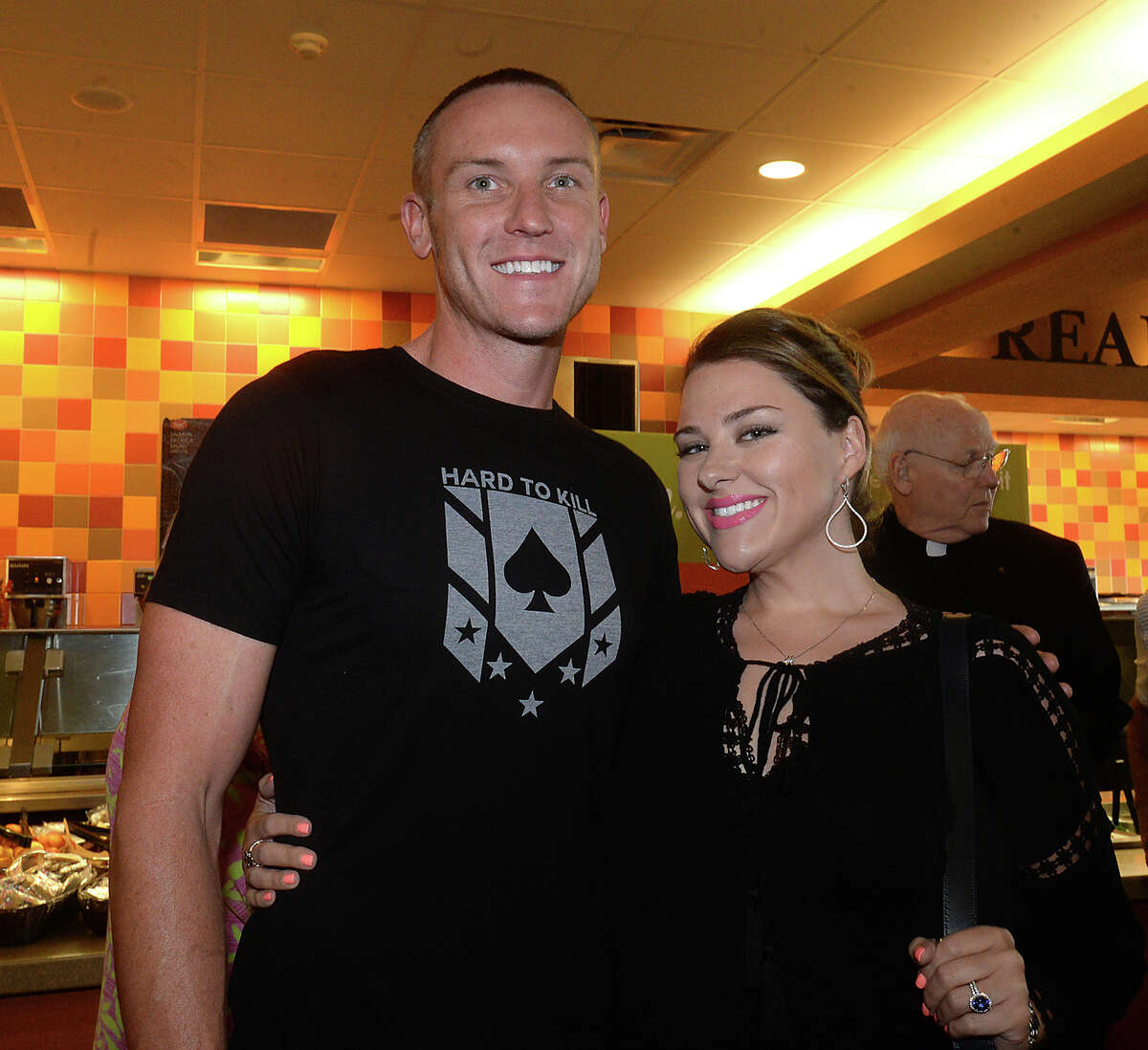 Cole Butler and Summer Penland were at the meet and greet rally for famous race car driver Mario Andretti at Jason's Deli in the Gateway Plaza Thursday. The event was the first social stop for Andretti, who was the celebrity host at this year's Champagne and Ribs fundraising gala Thursday night. Photo taken Thursday, April 20, 2017 Kim Brent/The Enterprise