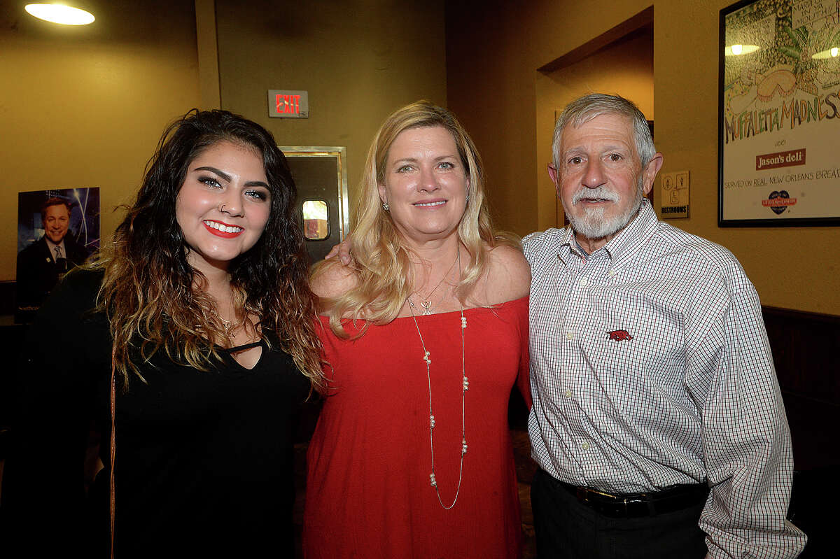 Maris Emma, Kathy, and George Thomas were at the meet and greet rally for famous race car driver Mario Andretti at Jason's Deli in the Gateway Plaza Thursday. The event was the first social stop for Andretti, who was the celebrity host at this year's Champagne and Ribs fundraising gala Thursday night. Photo taken Thursday, April 20, 2017 Kim Brent/The Enterprise