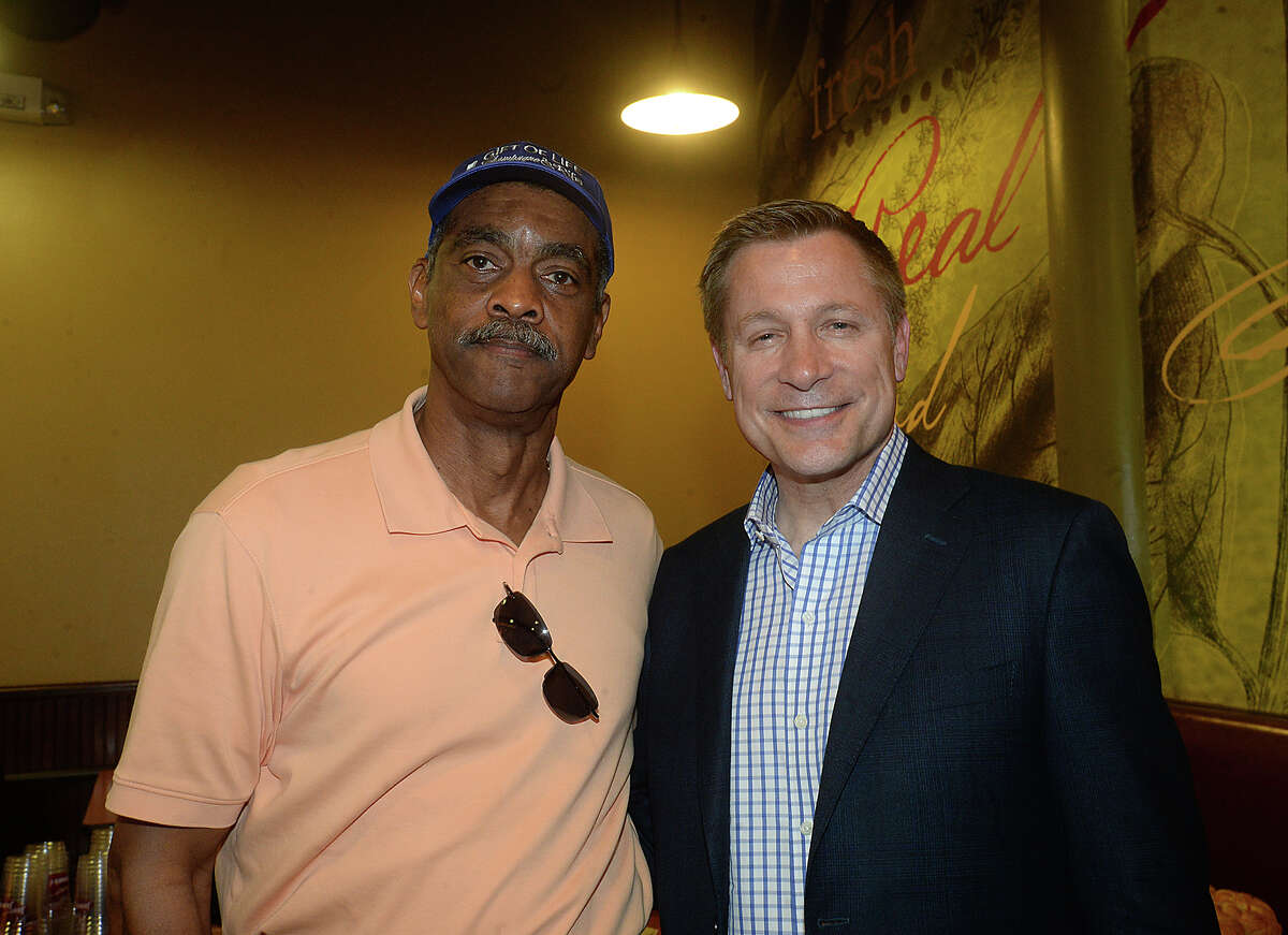 Vernon Durden and Bill Macatee were at the meet and greet rally for famous race car driver Mario Andretti at Jason's Deli in the Gateway Plaza Thursday. The event was the first social stop for Andretti, who was the celebrity host at this year's Champagne and Ribs fundraising gala Thursday night. Photo taken Thursday, April 20, 2017 Kim Brent/The Enterprise