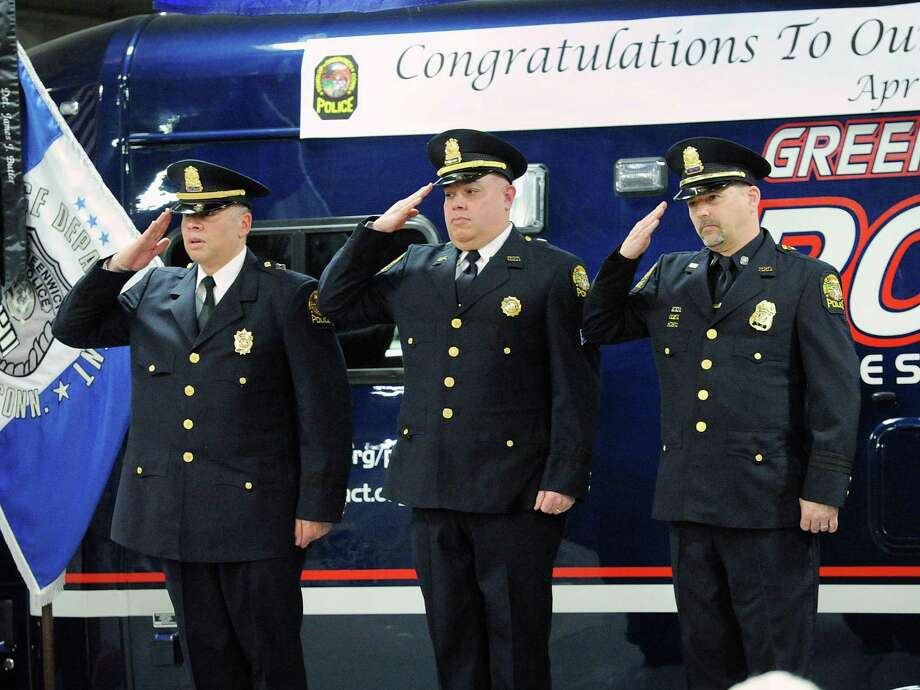 Greenwich Police Officers from left to right, Kraig Gray, John Rodriguez and David Colbree salute during a Greenwich Police Department promotional ceremony in which all three officers were promoted at the Greenwich Public Safety Complex in Greenwich, Conn., Thursday, April 20, 2017. Police Officer Gray was promoted from lieutenant to captain, Police Officer Rodriguez was promoted from sergeant to lieutenant and Police Officer Colbree was promoted from master police officer to sergeant. Photo: Bob Luckey Jr. / Hearst Connecticut Media / Greenwich Time