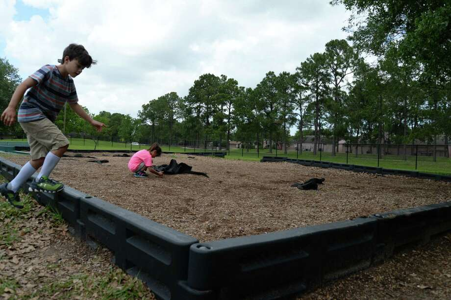 At Armand Bayou Elementary, Clear Creek ISD for safety reasons removed aging equipment, leaving monkey bars and mulch. If approved, a $487 million bond proposal on the May 6 ballot would provide playground makeovers at Armand Bay and 19 other schools.