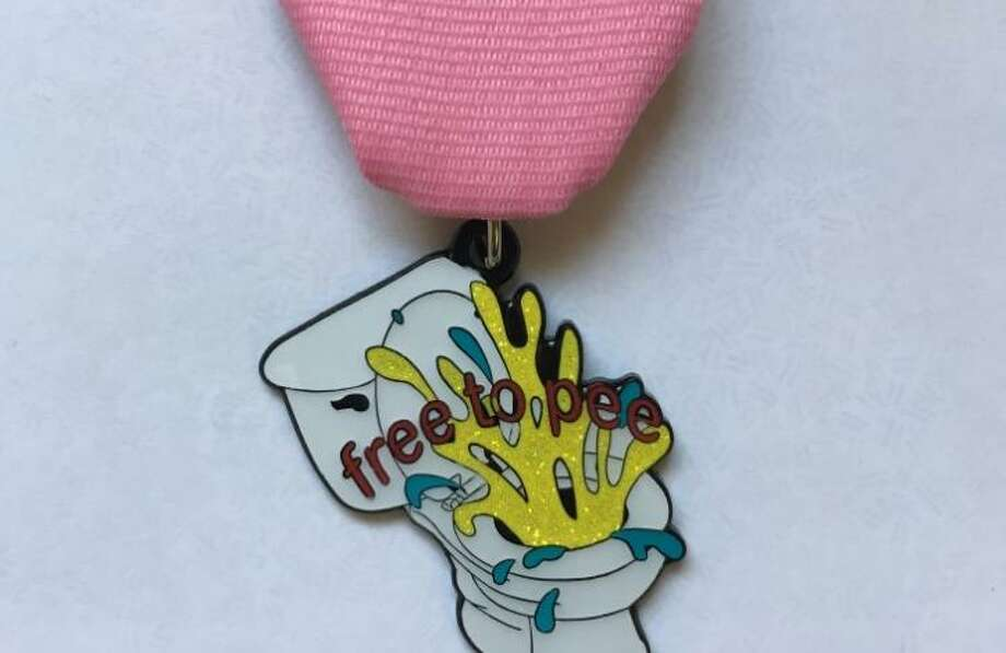 "Artist Chris Sauter said he designed the ""free to pee"" medal ""in protest of the so-called 'bathroom bill.'"" The medals are $10. Proceeds benefit Cornyation. To get one, contact the artist via Facebook or his web site, chrissauter.com. Photo: Courtesy Chris Sauter"
