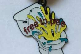 """Artist Chris Sauter said he designed the """"free to pee"""" medal """"in protest of the so-called 'bathroom bill.'"""" The medals are $10. Proceeds benefit Cornyation. To get one, contact the artist via Facebook or his web site, chrissauter.com."""