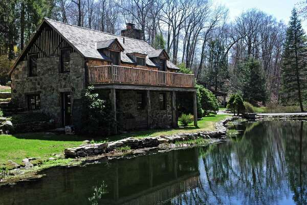The 1920 log and stone home at 367 Newtown Turnpike Thursday April 13, 2017, has been featured in over 30 national advertising campaigns including Ralph Lauren and Abercrombie,    and has been restored to combine modern amenities with country living in Weston, Conn.