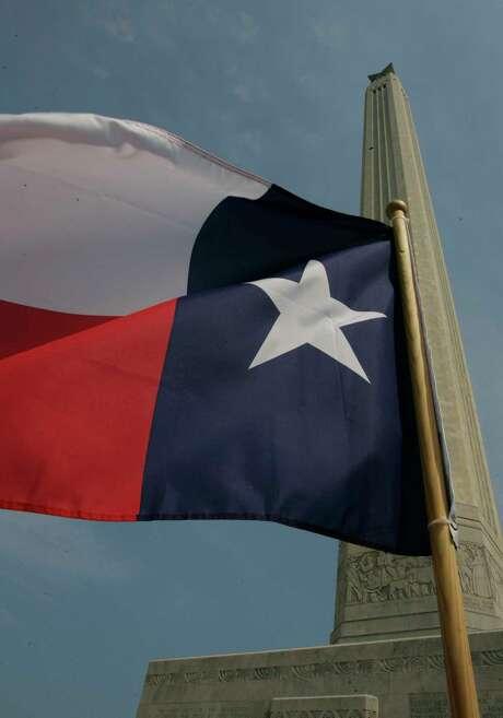 A Texas flag flies outside the San Jacinto Monument in La Porte.  (AP Photo/Pat Sullivan) Photo: PAT SULLIVAN, STF / AP