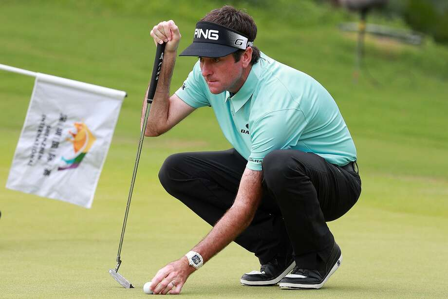 Bubba Watson lines up a putt during the first round of the Shenzhen International at Genzon Golf Club in China. Photo: Zhong Zhi, Getty Images