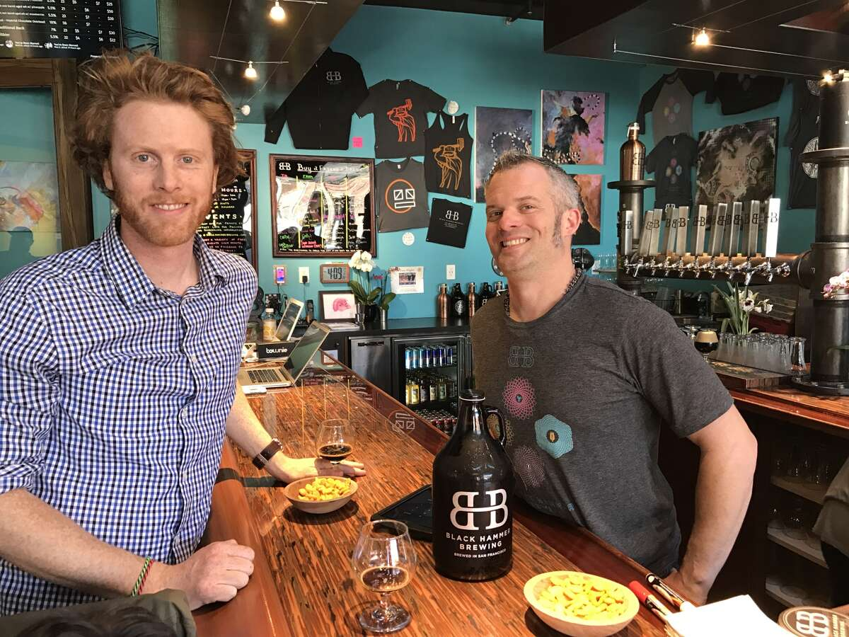 Black Hammer co-ownersBryan Hermannsson (left) and Jim Furman at their tap room.