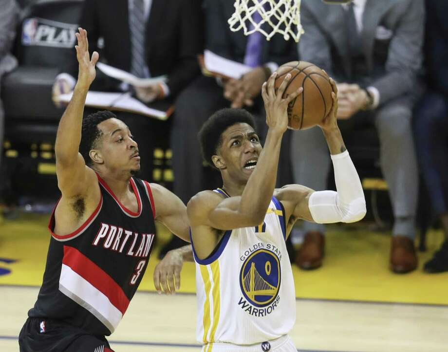 Golden State Warriors' Patrick McCaw goes up for a shot against Portland Trail Blazers' CJ McCollum in the second quarter during Game 2 of the First Round of the Western Conference 2017 NBA Playoffs at Oracle Arena on Wednesday, April 19, 2017 in Oakland, Calif. Photo: Scott Strazzante / The Chronicle / online_yes