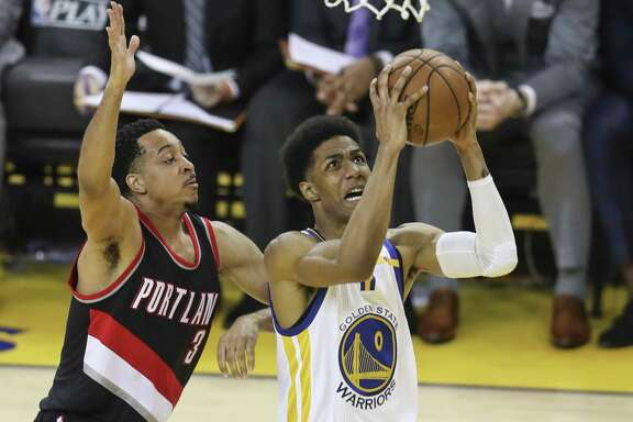 Golden State Warriors' Patrick McCaw goes up for a shot against Portland Trail Blazers' CJ McCollum in the second quarter during Game 2 of the First Round of the Western Conference 2017 NBA Playoffs at Oracle Arena on Wednesday, April 19, 2017 in Oakland, Calif.
