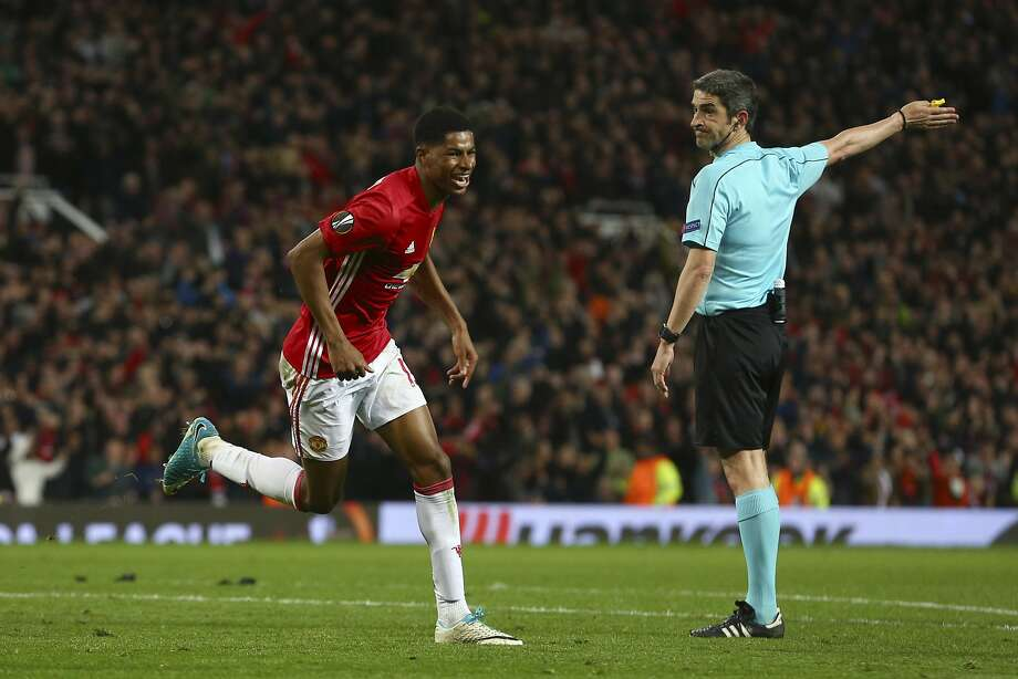 Manchester United's Marcus Rashford celebrates his goal as referee Alberto Undiano Mallenco observes. Photo: Dave Thompson, Associated Press