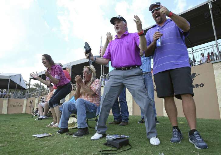 Fans watching at greenside erupt as Jimmy Walker places his tee shot within inches of the flag during the first round of the Valero Texas Open at TPC San Antonio Oaks Course on April 20, 2017.  From left are Terri and Keith Trice, Ron Fennell and Pat DeFrancesca.