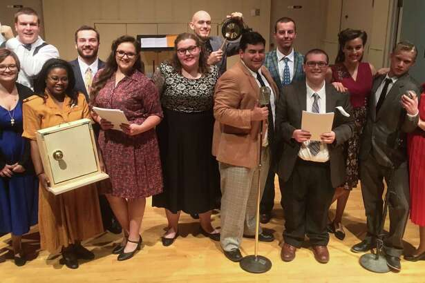 """Pasadena Memorial High graduate Tyler Fayad, center with the microphone, is having a  blast portraying characters in College of the Mainland's Radio Adventure Theatre.  """"It's full of adventure and cliffhangers, and it's hilarious,"""" says Fayad, who is a theater major at the school."""