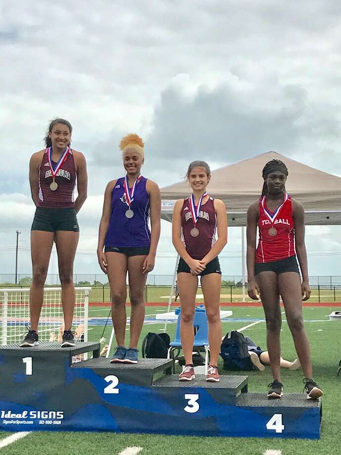 Shown here are the winners of the girls District 19-20 Area meet high jump. From left is Alex Glover (Magnolia), Brianna McKean (Willis), Ally Myers (Magnolia) and Christina Thomas (Tomball). Photo: Photo Provided