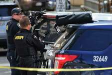 Officers respond after two Seattle Police Department officers were shot while responding to a robbery in downtown Seattle on Thursday, April 20, 2017.