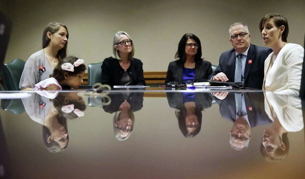 Libby Gonzales, a transgender girl, sits with her mother, Rachel, during a news conference at the Capitol held by foes of the bathroom bill.
