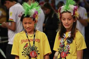 Loan Hoang (left) and Iris Ochoa of Team Sparrowbots react to their robot's performance Thursday at the George R. Brown Convention Center. More than 15,000 students  from 24 states and 33 countries are competing.