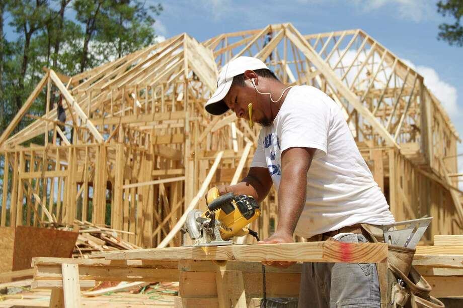 Building continues on a home in Grand Central Park, Wednesday, April 19, 2017, in Conroe. The master planned community is expected to have 2,7000 homes build within the next 10 years. Photo: Jason Fochtman, Staff Photographer / © 2017 Houston Chronicle