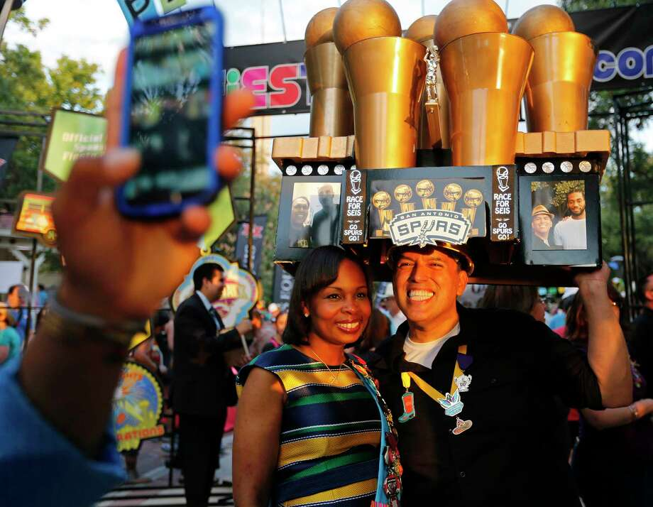Mayor Ivy Taylor poses for photos with John Watts Nieto and his Spurs Race For Seis Trophy Hat during the Fiesta Fiesta event held Thursday April 20, 2017 at Hemisfair Park. Photo: Edward A. Ornelas, San Antonio Express-News / © 2017 San Antonio Express-News