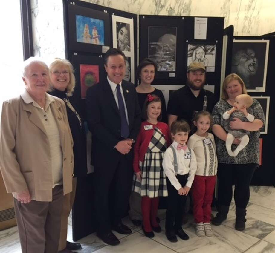 Assemblyman Pete Lopez stands with art exhibit winners Stamford students Lillian Eklund and Jayce Blanchard and their families at the Legislative Student Art Exhibition presented by the New York State Art Teachers Association Legislative Student Art Exhibit. Their pieces were chosen from submissions across the state to be displayed at the exhibit. (Photo provided)