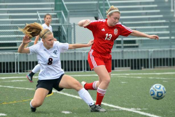Edwardsville defender Sarah Kraus, left, attempts to tackle the ball away from a Chatham Glenwood player during first-half action inside the District 7 Sports Complex.