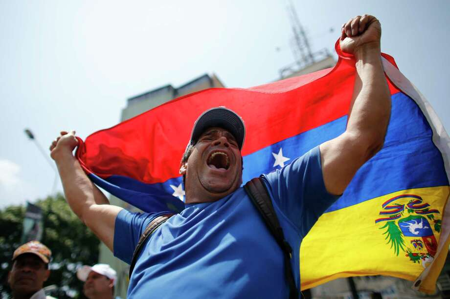 A man shouts anti-government slogans during a protest in Caracas, Venezuela, Thursday, April 20, 2017. Venezuela's opposition is calling for another day of protests against President Maduro after mass demonstrations Wednesday resulted in two deaths. (AP Photo/Ariana Cubillos) ORG XMIT: XRM172 Photo: Ariana Cubillos / Copyright 2017 The Associated Press. All rights reserved.