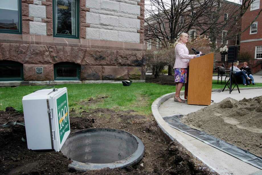 The Sage Colleges President, Susan Scrimshaw addresses those gathered for an event to bury a time capsule as part of the college's centennial celebration on Thursday, April 20, 2017, in Troy, N.Y.  The capsule  includes a wide variety of items demonstrating Sage's history, including pieces donated by alumni as well as contributions from the Sage Community.  The capsule will be opened in 50 years.   (Paul Buckowski / Times Union) Photo: PAUL BUCKOWSKI / 20040312A