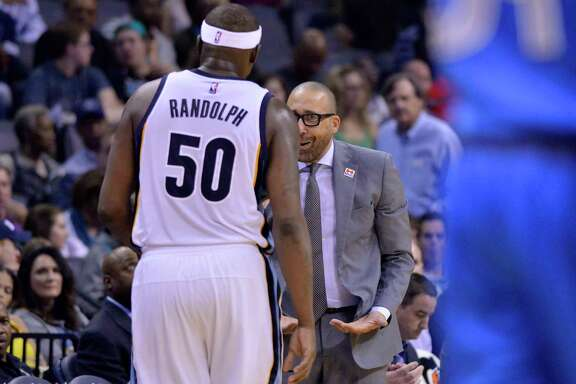 Memphis Grizzlies forward Zach Randolph (50) is greeted by head coach David Fizdale as he leaves the court in the first half of an NBA basketball game against the Dallas Mavericks, Friday, March 31, 2017, in Memphis, Tenn. (AP Photo/Brandon Dill)