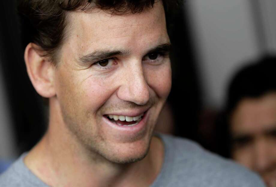New York Giants quarterback Eli Manning talks to reporters during an availability ahead of the NFL Football draft, Thursday, April 20, 2017, in East Rutherford, N.J. (AP Photo/Julio Cortez) ORG XMIT: NJJC104 Photo: Julio Cortez / Copyright 2017 The Associated Press. All rights reserved.
