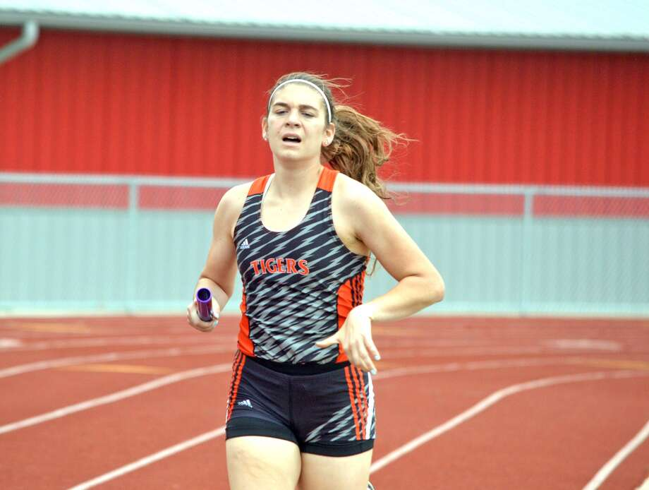 Edwardsville junior Haley Allard competes in the second leg of the 3,200-meter relay during the Alton Invitational on Thursday.