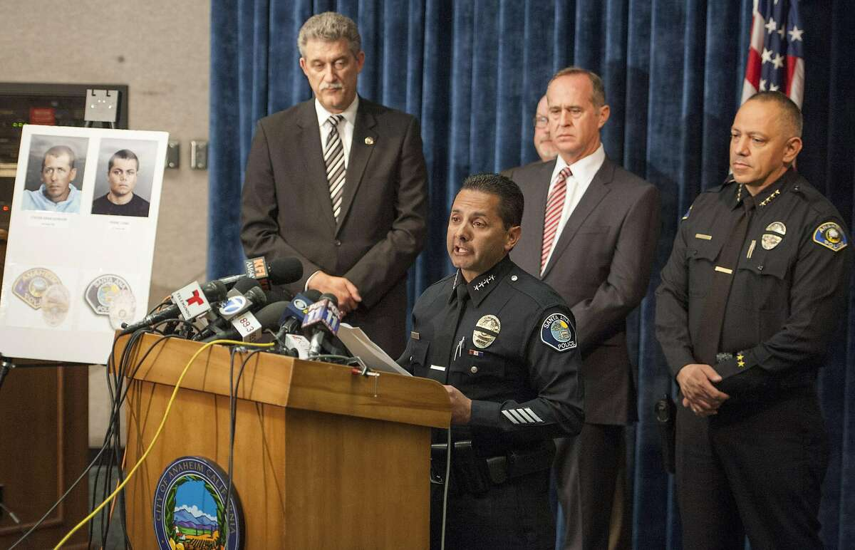 Santa Ana Police Chief Carlos Rojas speaks at a news conference, Monday, April 14, 2014, in Anaheim, Calif., to publicly discuss the deaths of four women allegedly raped and killed by two parolees wearing GPS trackers. (AP Photo/The Orange County Register, Leonard Ortiz)