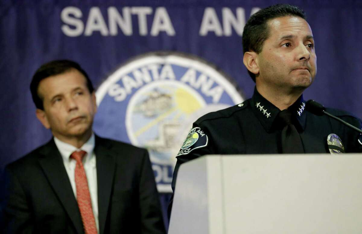 Santa Ana Mayor Miguel Pulido (left) looks on as Police Chief of Police Carlos Rojas describes the details of a hit-and-run that killed three teenagers in 2014.
