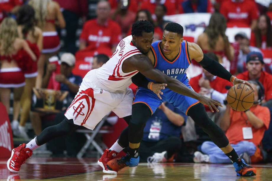 Russell Westbrook, right, is guarded by Pat Beverley of the Rockets during Wednesday's game in Houston. The series resumes tonight at Oklahoma City.  Photo: Michael Ciaglo, Staff / Michael Ciaglo